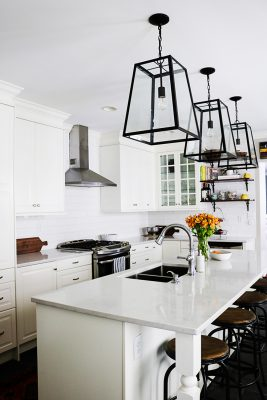 white kitchen cabinets, white quartz countertops, lantern style pendant lights, subway tile