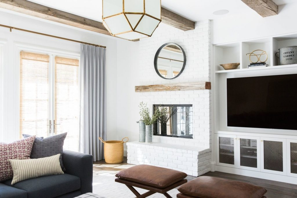 white brick fireplace with built-ins on one side by Studio McGee