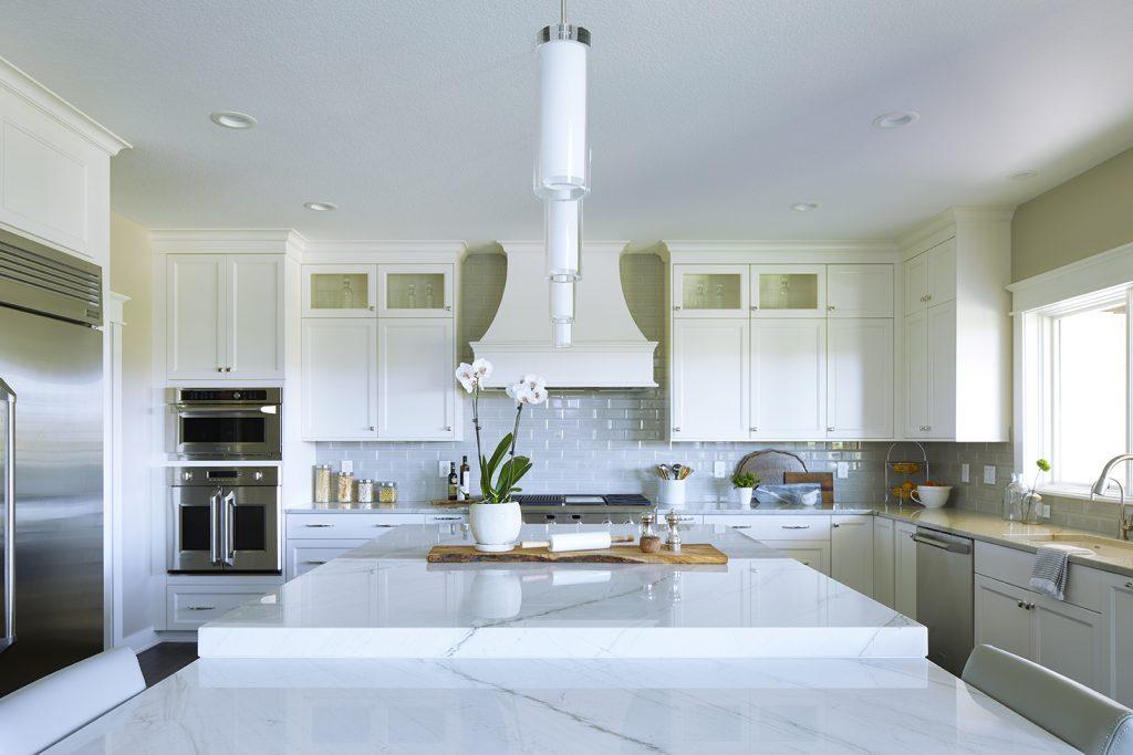white kitchen two-height island parthenon quartzite