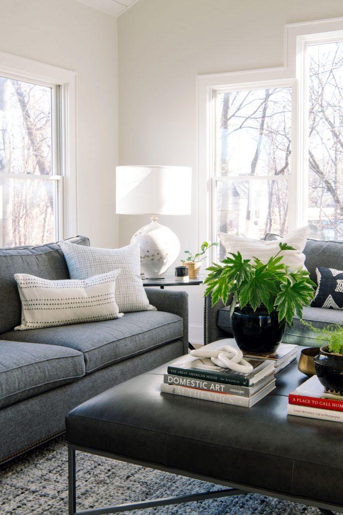 sun room gray sofa leather ottoman