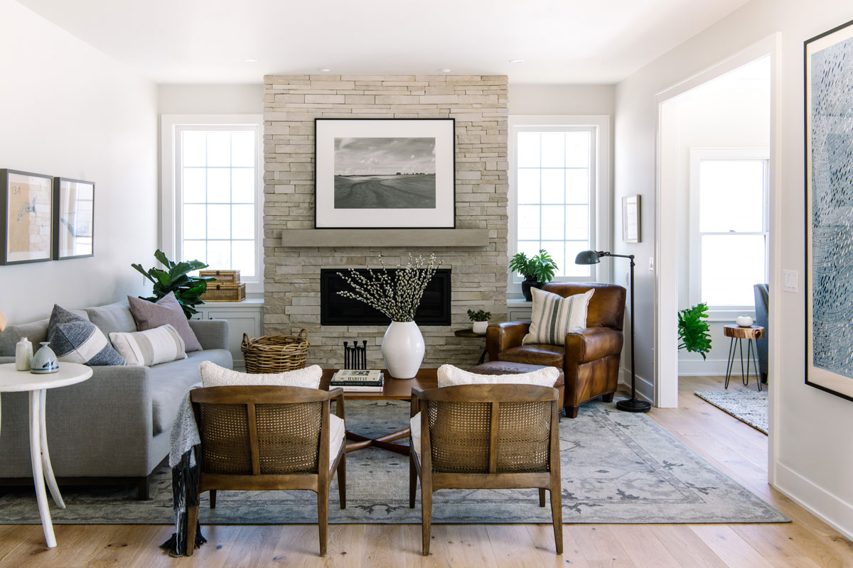 transitional living room stacked stone fireplace