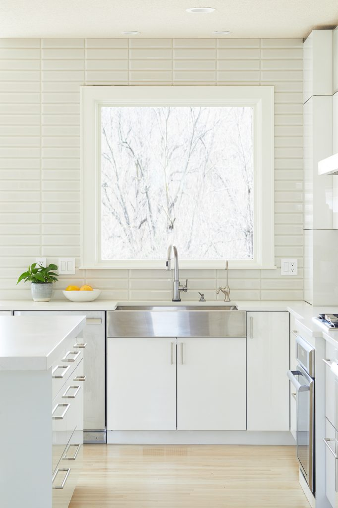 White and Gray Modern Kitchen with stainless steel farmhouse sink by Jillian Lare Des Moines Interior Designer