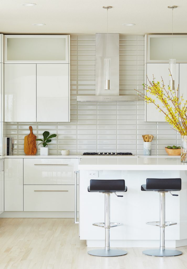 White and Gray Modern Kitchen with high gloss white cabinets by Jillian Lare Des Moines Interior Designer