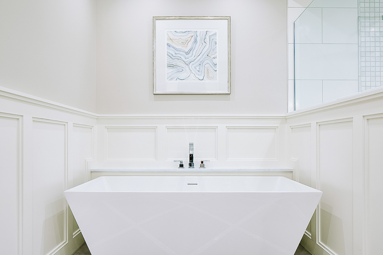 Modern freestanding tub with wainscot surround
