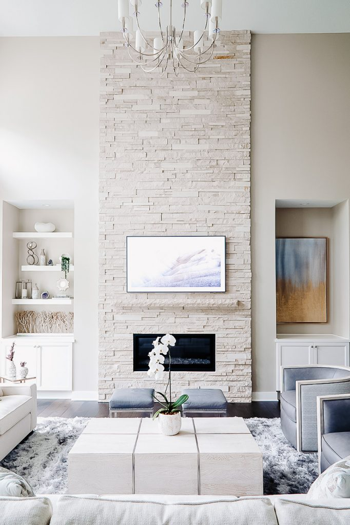 Light stacked stone fireplace with Samsung Frame TV